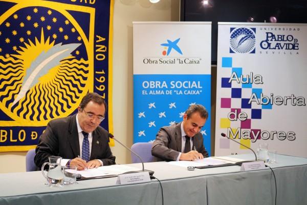 Vicente Guzmán y Rafael Herrador durante la firma del convenio